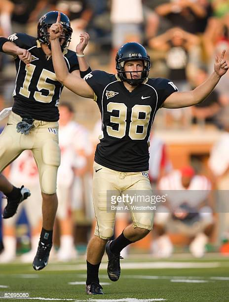 Kicker Sam Swank and holder Ryan McManus of the Wake Forest Demon Deacons celebrate following Swank's 41-yard game winning field goal against the Ole...