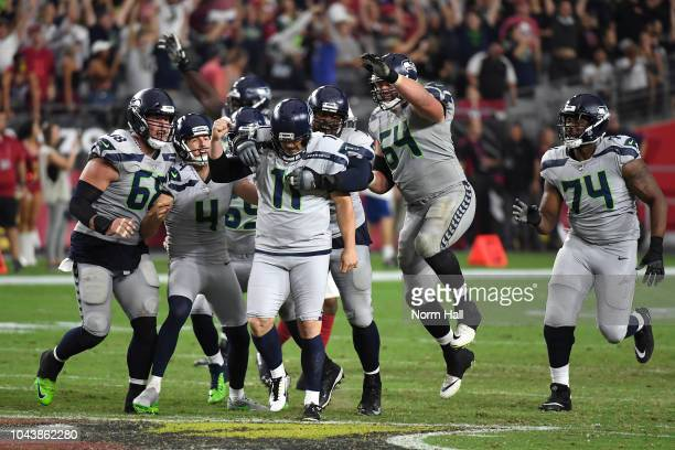 Kicker Sebastian Janikowski of the Seattle Seahawks celebrates with teammates offensive guard JR Sweezy and center Justin Britt after kicking the...