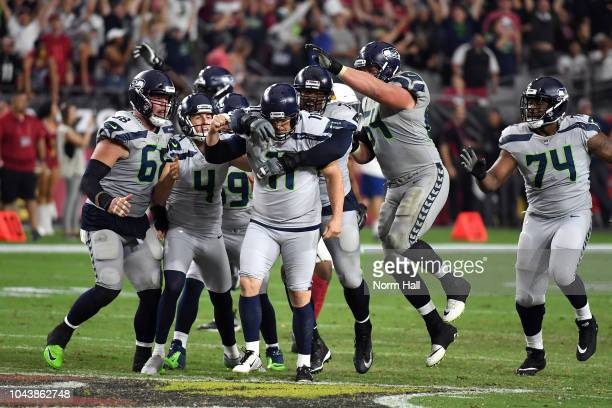 Kicker Sebastian Janikowski of the Seattle Seahawks celebrates with teammates offensive guard JR Sweezy and punter Michael Dickson after kicking the...