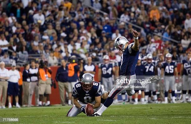 Kicker Stephen Gostkowski of the New England Patriots kicks a field goal as Josh Miller holds during a preseason game against the Washington Redskins...
