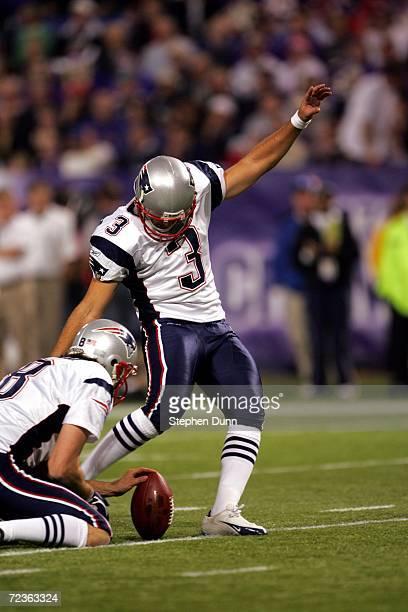 Kicker Stephen Gostkowski of the New England Patriots kicks the ball as punter Josh Miller holds during the game against the Minnesota Vikings on...
