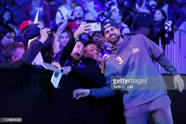 Kicker Stephen Gostkowski of the New England Patriots poses with fans during Super Bowl LIII Opening Night at State Farm Arena on January 28 2019 in...