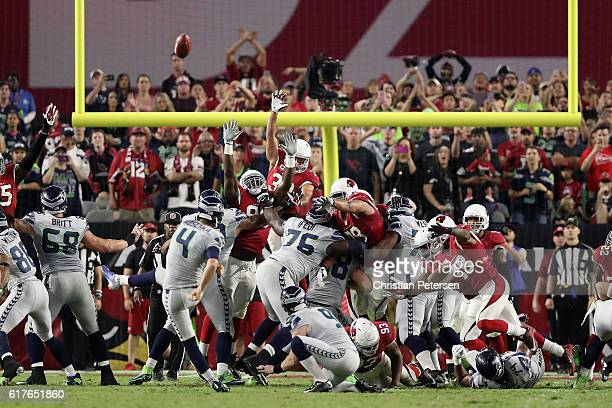 Kicker Stephen Hauschka of the Seattle Seahawks misses a field goal in overtime as the Arizona Cardinals attempt to block during the NFL game at the...