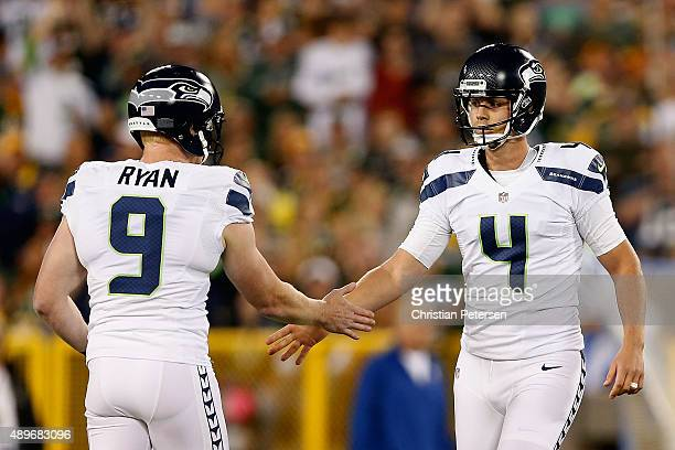 Kicker Steven Hauschka of the Seattle Seahawks highfives punter Jon Ryan after kicking a field goal against the Green Bay Packers during the NFL game...