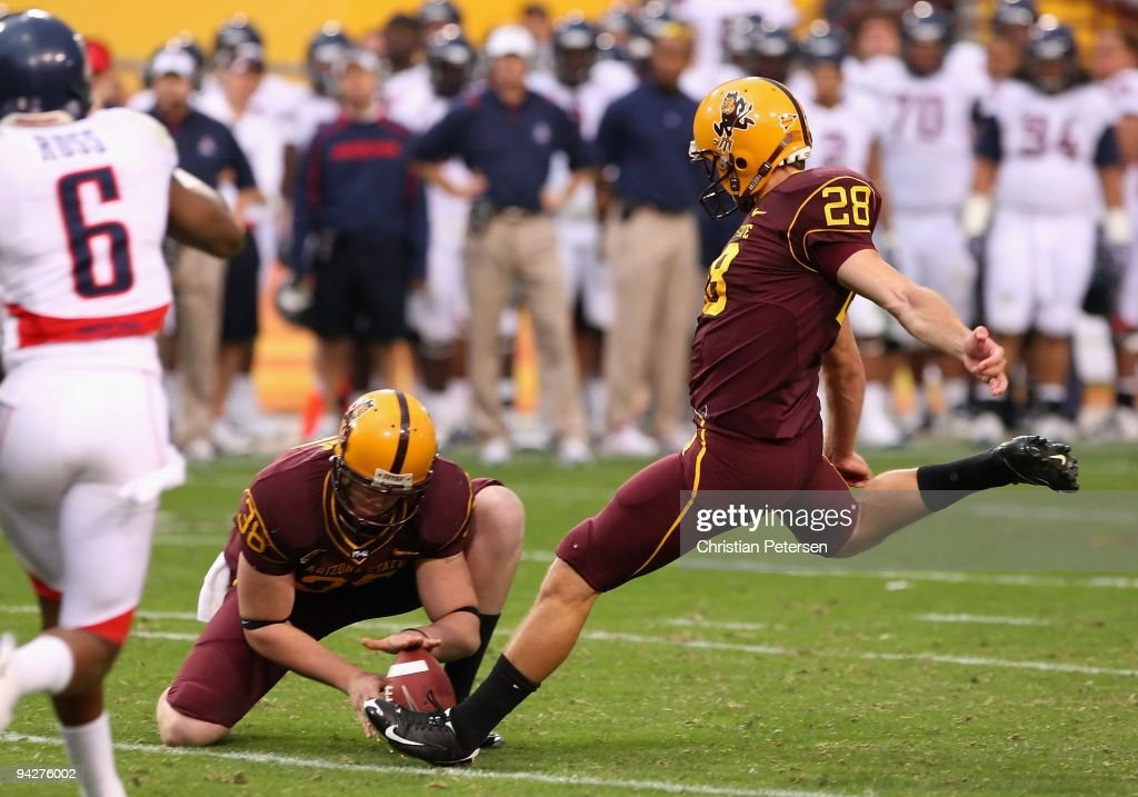 Kicker Thomas Weber #28 of the Arizona State Sun Devils attempts a field goal against the Arizona Wildcats during the first quarter of the college football game at Sun Devil Stadium on November 28, 2009 in Tempe, Arizona.