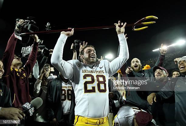 Kicker Thomas Weber of the Arizona State Sun Devils celebrates after defeating the Arizona Wildcats in college football game at Arizona Stadium on...