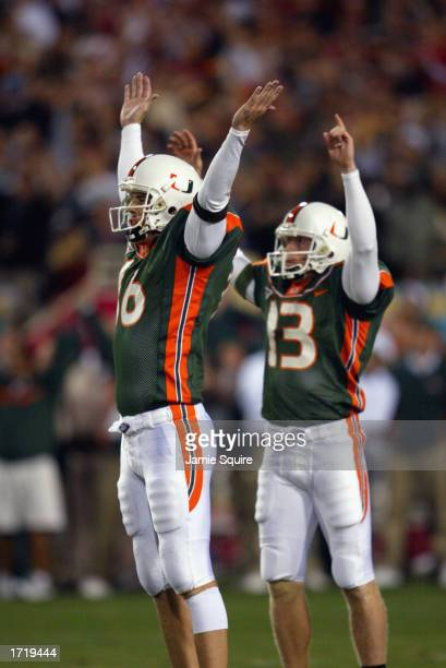 Kicker Todd Sievers of the University of Miami Hurricanes celebrates with holder Freddie Capshaw after kicking the game tying field goal against the...