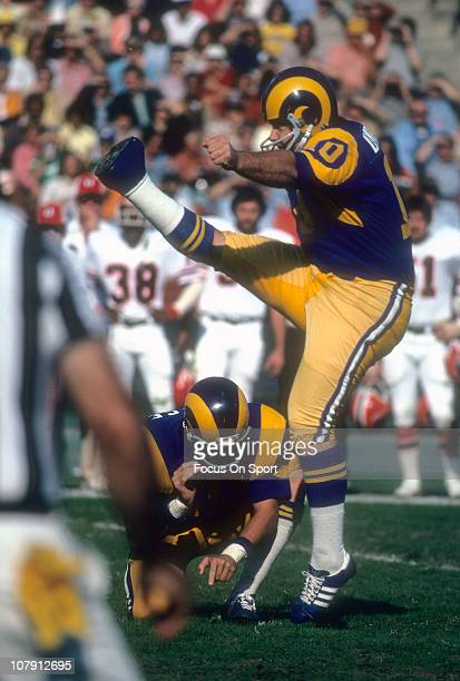 Kicker Tom Dempsey of the Los Angeles Rams kicks a field goal against the St Louis Cardinals during an NFL football game at Los Angeles Memorial...