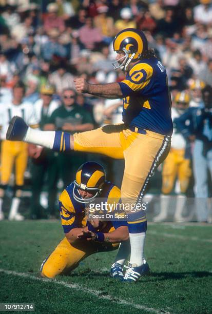 Kicker Tom Dempsey of the Los Angeles Rams kicks a field goal against the Green Bay Packers during an NFL football game at Los Angeles Memorial...