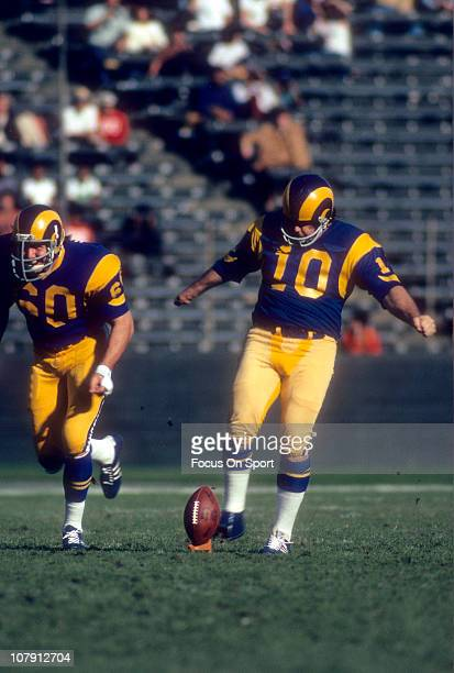 Kicker Tom Dempsey of the Los Angeles Rams kicks off against the Green Bay Packers during an NFL football game at Los Angeles Memorial Coliseum...