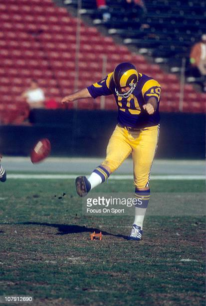 Kicker Tom Dempsey of the Los Angeles Rams kicks off against the St. Louis Cardinals during an NFL football game at Los Angeles Memorial Coliseum...