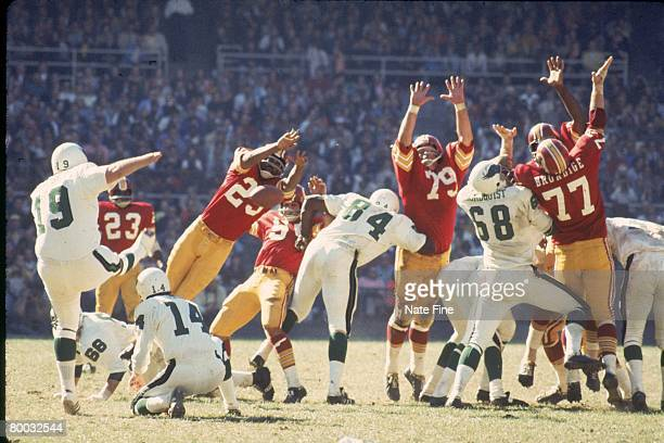 Kicker Tom Dempsey of the Philadelphia Eagles attempts a field goal against the Washington Redskins at RFK Stadium on October 8 1972 in Washington DC...