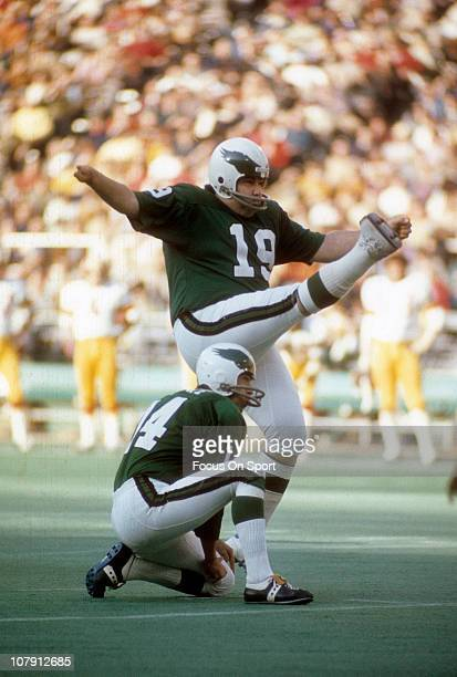 Kicker Tom Dempsey of the Philadelphia Eagles kicks a field goal with Pete Liske doing the holding against the Washington Redskins during an NFL...