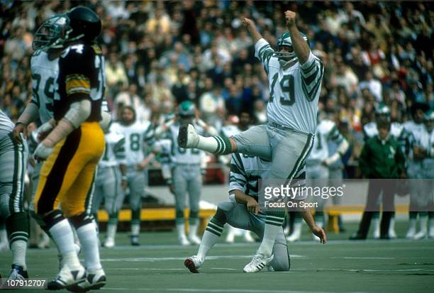 Kicker Tom Dempsey of the Philadelphia Eagles kicks a field goal with Bill Bradley doing the holding against the Pittsburgh Steelers during an NFL...