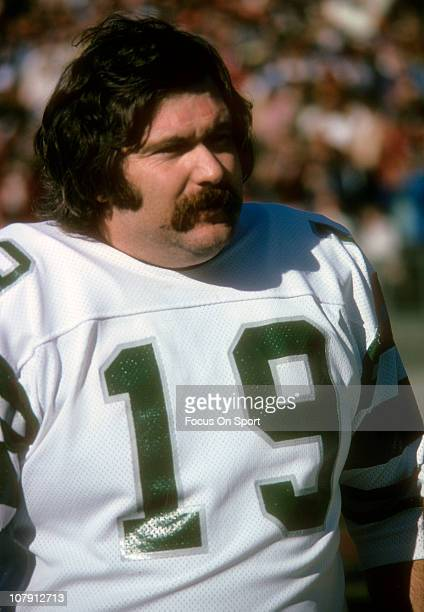 Kicker Tom Dempsey of the Philadelphia Eagles looks on from the sidelines during an NFL football game circa 1974 Dempsey played for the Eagles from...