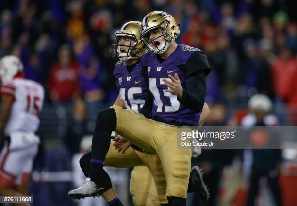 Kicker Tristan Vizcaino of the Washington Huskies celebrates with holder Race Porter after kicking the winning field goal to beat the Utah Utes 3330...