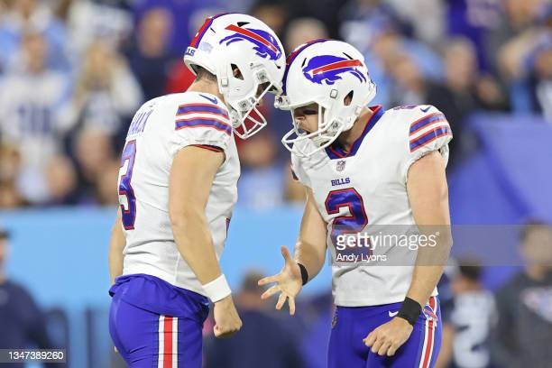 Kicker Tyler Bass of the Buffalo Bills celebrates with teammate Matt Haack after kicking a field goal against the Tennessee Titans during the third...