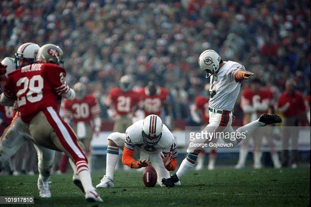 Kicker Uwe von Schamann of the Miami Dolphins kicks on a hold by Don Strock against the San Francisco 49ers during Super Bowl XIX at Stanford Stadium...