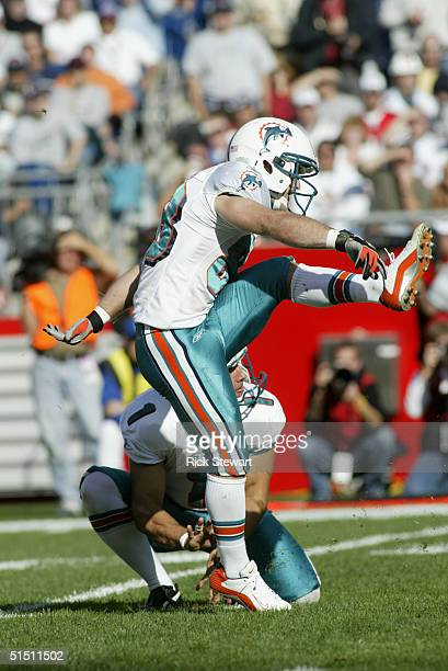 Kicker Wes Welker of the Miami Dolphins kicks the ball off a hold by his punter Matt Turk during the game against the New England Patriots at...