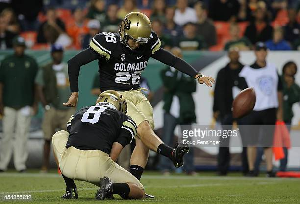 Kicker Will Oliver of the Colorado Buffaloes kicks a 23 yard field goal from the hold of Darragh O'Neill of the Colorado Buffaloes to give the Buffs...