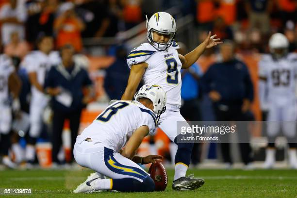 Kicker Younghoe Koo of the Los Angeles Chargers kicks a field goal on a hold by Drew Kaser against the Denver Broncos at Sports Authority Field at...