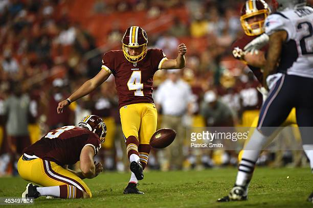 Kicker Zach Hocker of the Washington Redskins kicks a field goal against the New England Patriots during a preseason NFL game at FedExField on August...