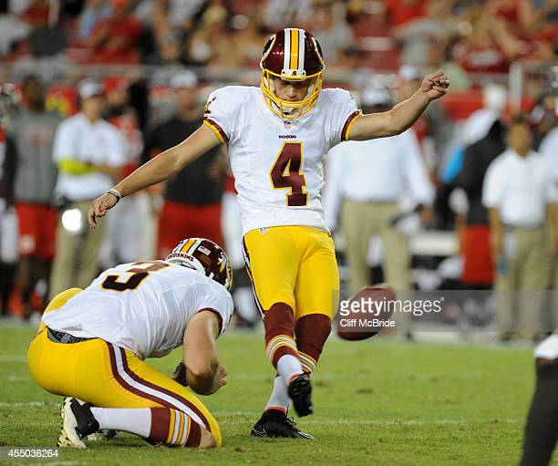 Kicker Zach Hocker of the Washington Redskins kicks a field goal against the Tampa Bay Buccaneers at Raymond James Stadium on August 28 2014 in Tampa...