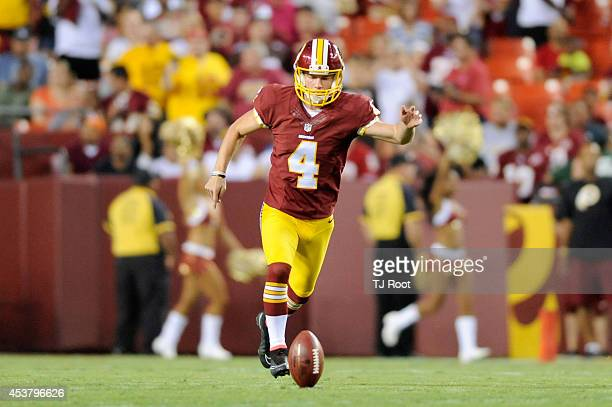 Kicker Zach Hocker of the Washington Redskins kicks off during a preseason football game against the Cleveland Browns at FedExField on August 18 2014...