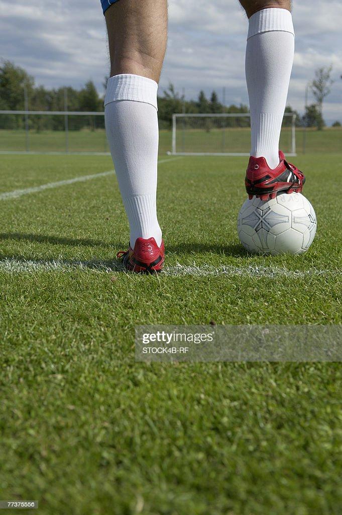 Kicker's foot standing on ball : Photo