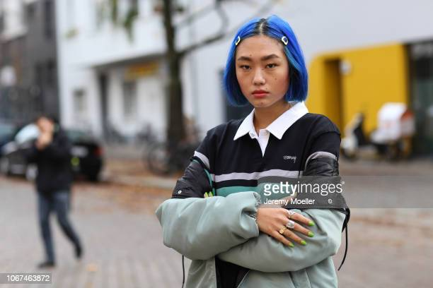 Kicki Yang Zhang wearing a Stussy jacket and shirt on November 14 2018 in Berlin Germany
