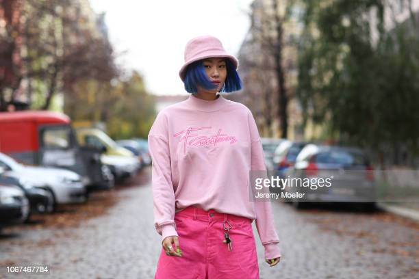 Kicki Yang Zhang wearing Buffalo shoes Landlord trousers Local Heroes sweater ASOS cap on November 14 2018 in Berlin Germany
