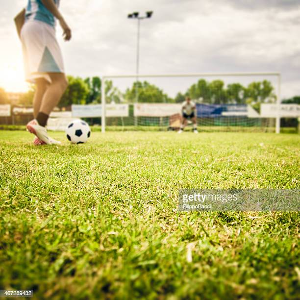 kicking a penalty - shootout stock pictures, royalty-free photos & images