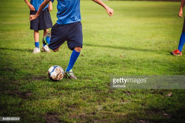 kicking a soccer ball - sports league stock pictures, royalty-free photos & images