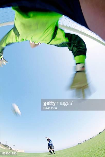 Kicking Ball Toward Soccer Goalie