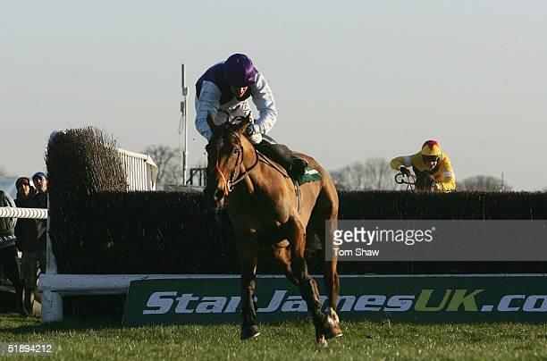 Kicking King ridden by Barry Geraghty almost falls at the final fence but goes on the win the Stan James King Georges VI Steeple Chase at Kempton...