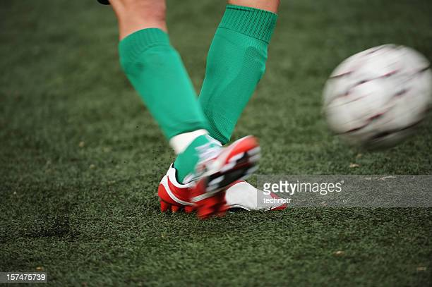 kicking - shooting at goal stock pictures, royalty-free photos & images