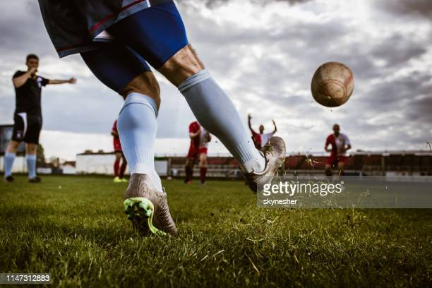 kicking the ball at the beginning of rugby match! - kicking stock pictures, royalty-free photos & images