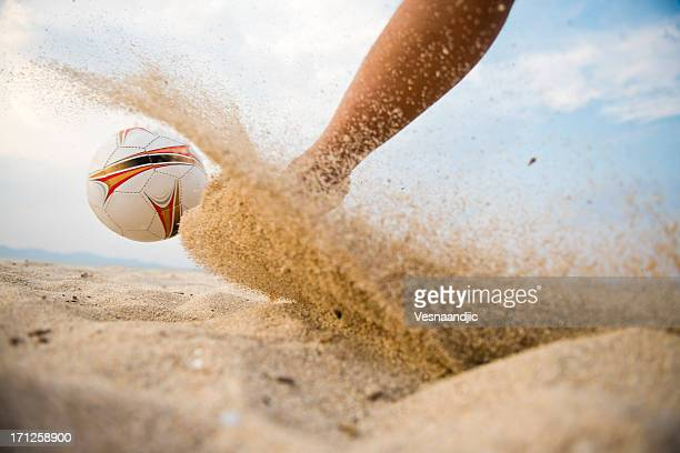 Kicking the ball with sand