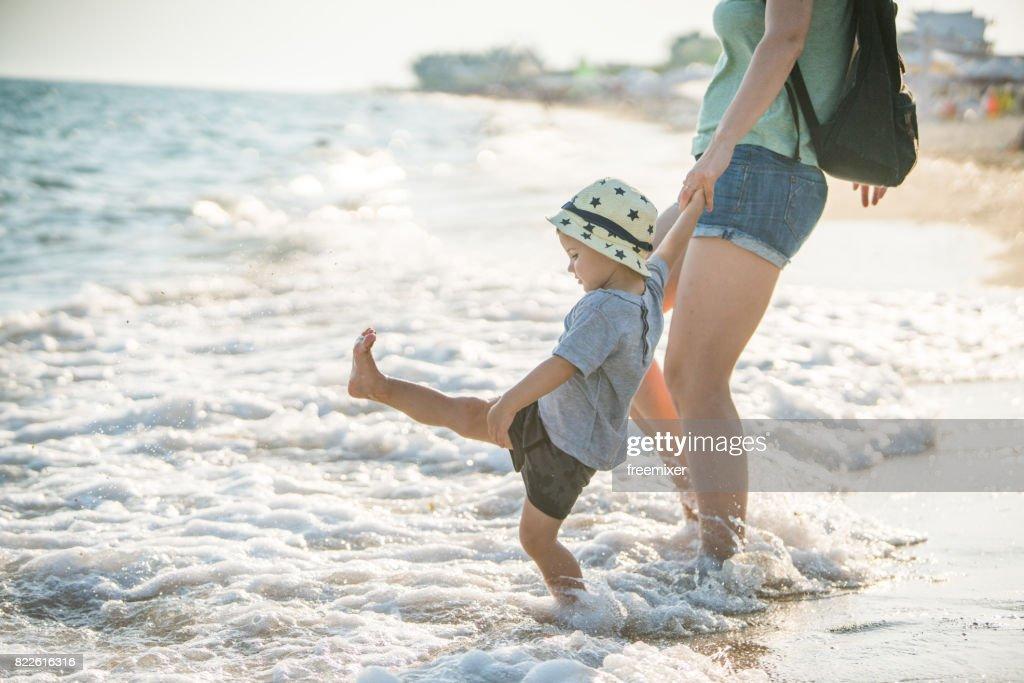 Kicking the waves : Stock Photo