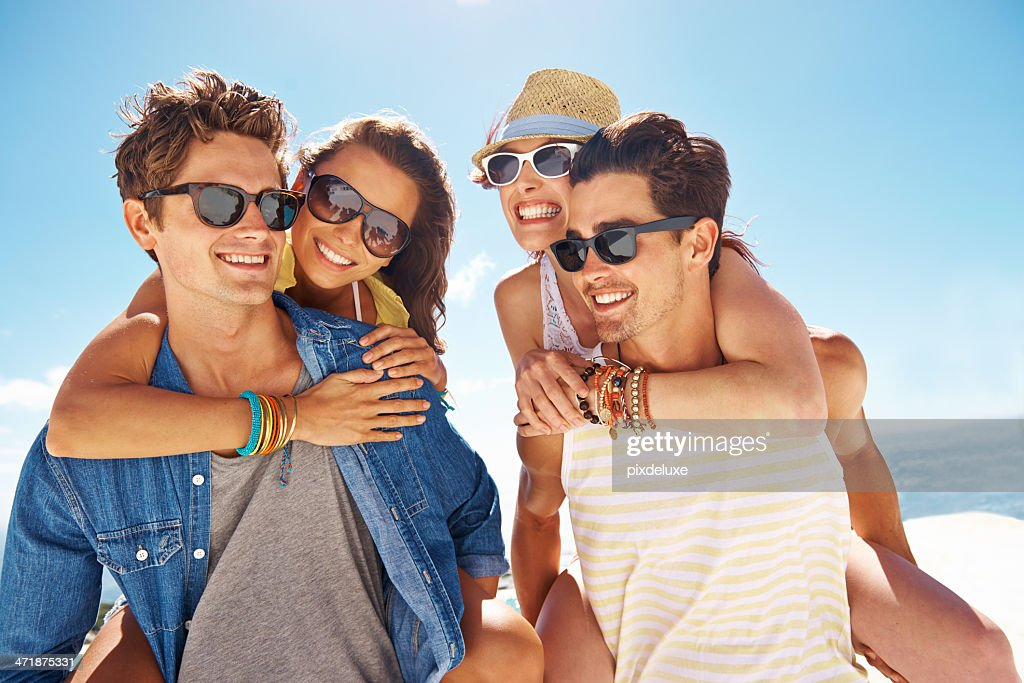 Kicking their holiday off in the sun : Stock Photo
