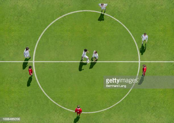 kick-off on soccer field, aerial view - play off stock pictures, royalty-free photos & images