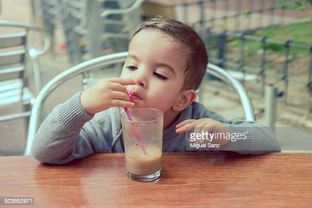 Kid, 2-3 years, drinking chocolate milk