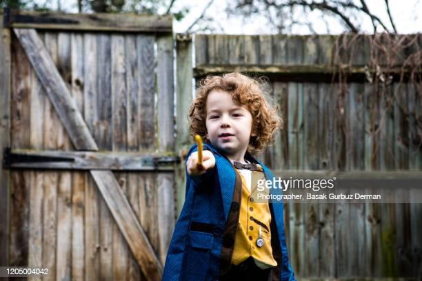 kid acting, making magic tricks - magician photos et images de collection