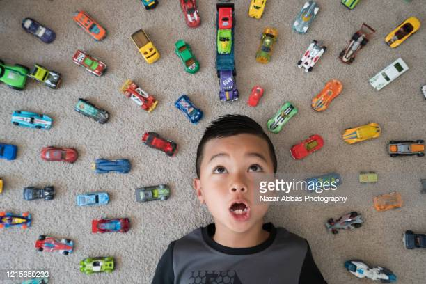 kid at home playing with his cars. - grand groupe d'objets photos et images de collection