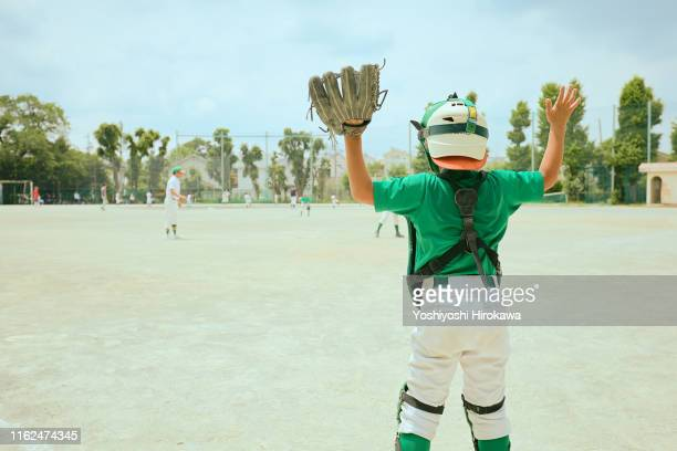 kid (10-11) baseball catcher encouraging fellow - baseball catcher stock pictures, royalty-free photos & images
