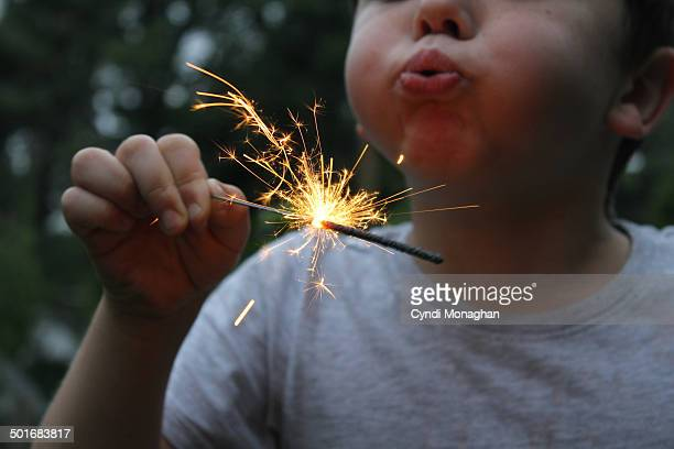 Kid Blowing on Sparkler