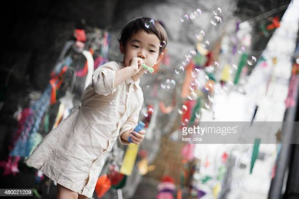 a kid blows soap bubbles - tanabata festival stock pictures, royalty-free photos & images