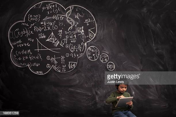 Kid boy on tablet in front of math thought bubble