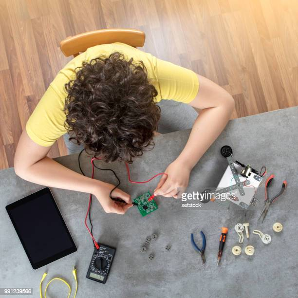 kid builds a robot - inventor stock pictures, royalty-free photos & images