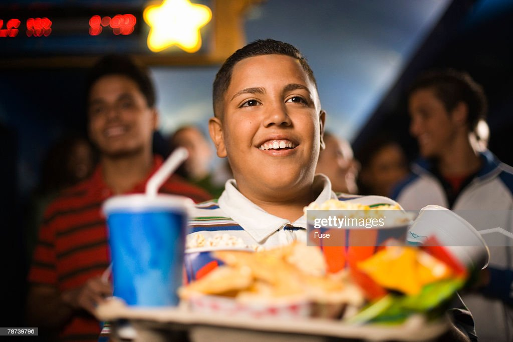 Kid Buying Junk Food at the Movies : Stock-Foto